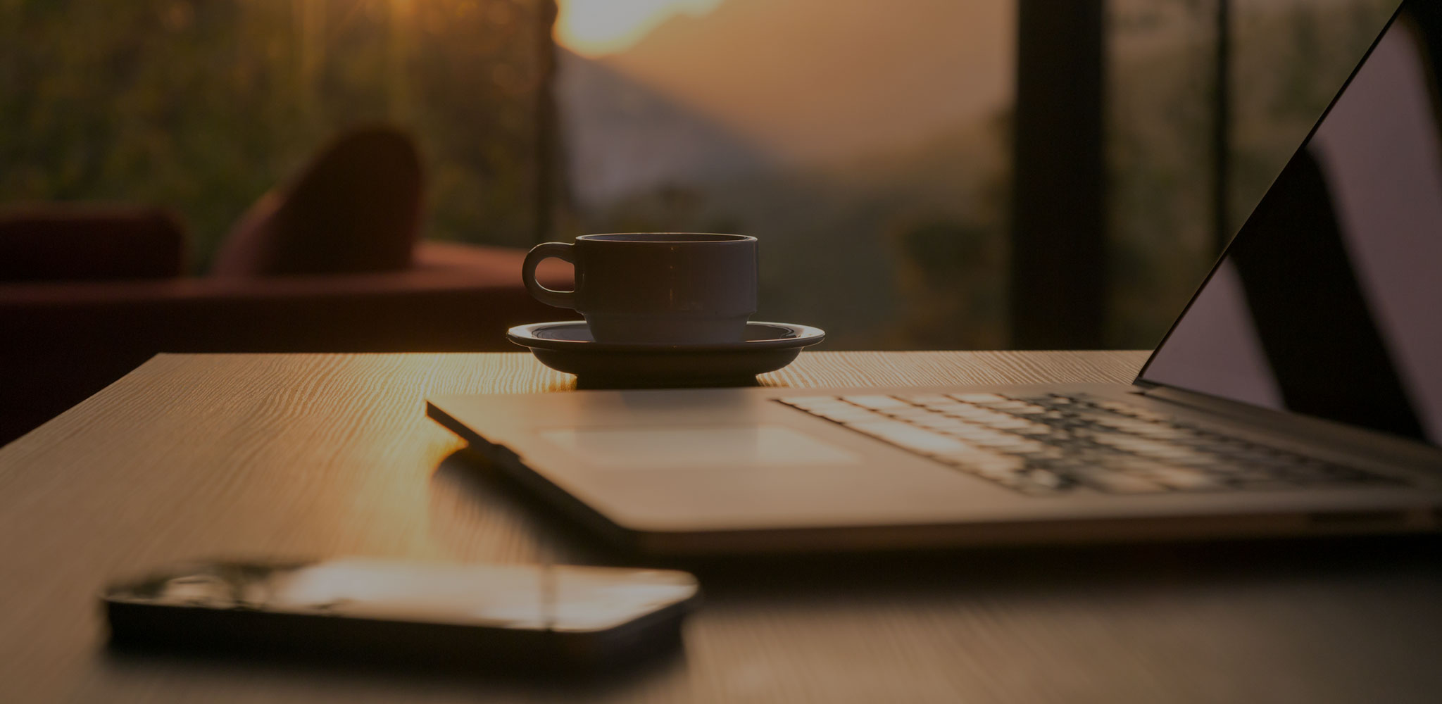 Coffee and Laptop by Window